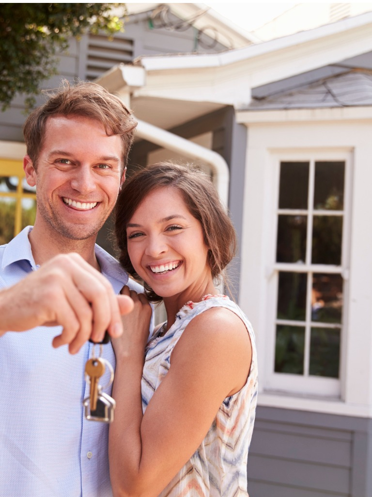 couple-with-keys-standing-outside-new-home-picture-id640228744